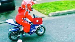 A 3-year-old boy rides an electric Pocket Bike from Nitro Motors